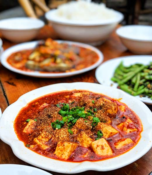 Mapo tofu and other food on a table in Chengdu, China