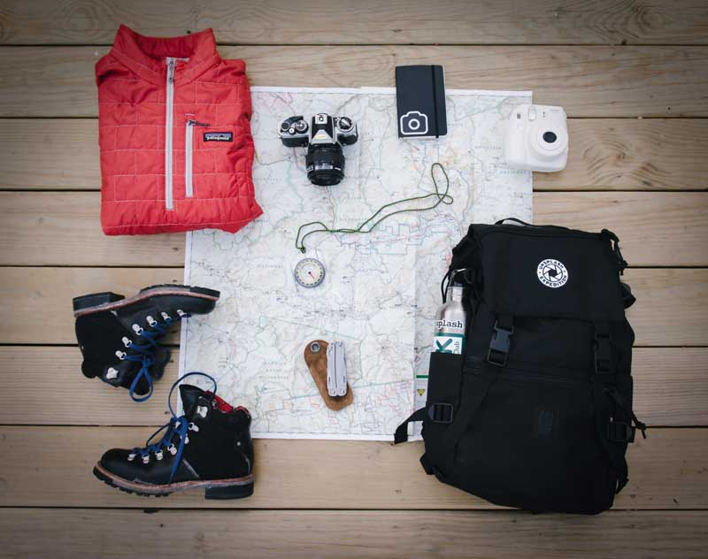 hiking travel gear laid out to pack