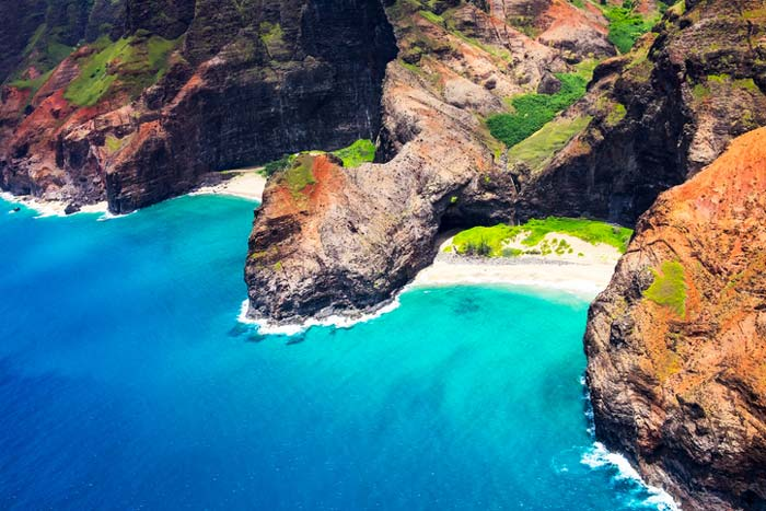 Aerial landscape view of Honopu Arch at Na Pali coastline, Kauai, Hawaii