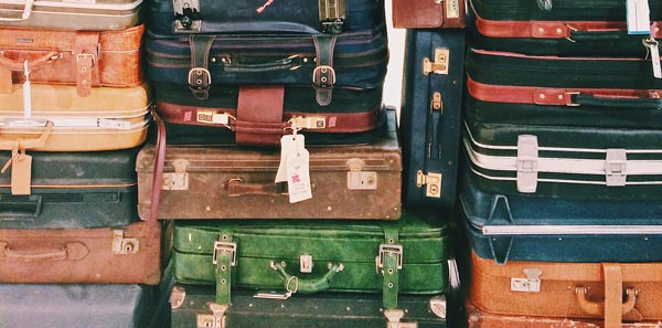 pile of suitcases packed for a cruise