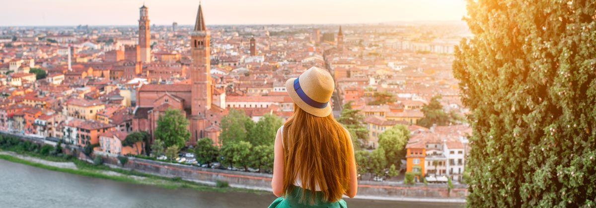 A woman looking at the cityscape of Verona, Italy