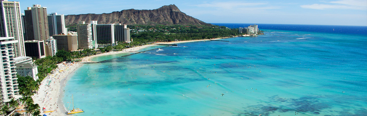 View from above looking down on hotels and tourists on Waikiki Beach and Diamond Head in Honolulu, Hawaii