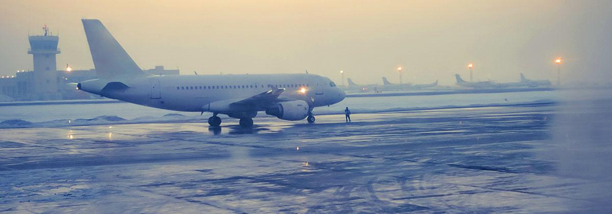 plane stuck on runway in winter storm