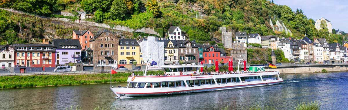 A river cruise on the Rhein passing through the medieval town of Cochem, Germany.