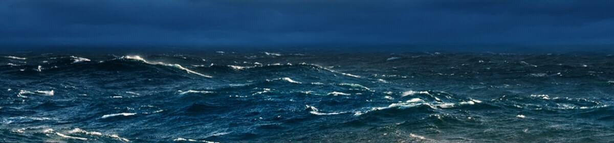 Stormy seas with white capped waves, possibly a hurricane brewing.