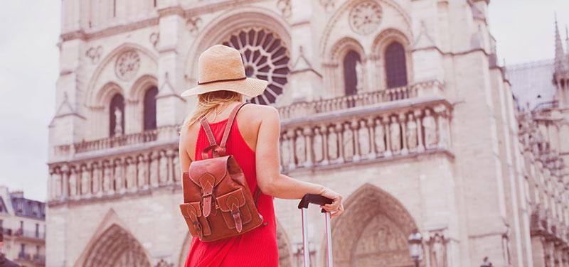 Tourist visiting Notre Dame de Paris